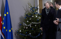 British Prime Minister Theresa May, center, walks past a holiday tree as she leaves the Europa building after a meeting with European Council President Donald Tusk in Brussels, on Dec. 11 2018. (AP Photo/Virginia Mayo)