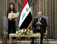Nobel Peace Prize laureate Nadia Murad, left, speaks during a meeting with her country's President Barham Salih, in Baghdad, Iraq, on Dec. 12, 2018. (AP Photo/Karim Kadim)