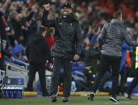 Liverpool coach Juergen Klopp gestures during the Champions League Group C soccer match between Liverpool and Napoli at Anfield stadium in Liverpool, England, on Dec. 11, 2018.(AP Photo/Dave Thompson)
