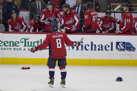 Washington Capitals left wing Alex Ovechkin (8), from Russia, celebrates his goal for a hat trick in the third period of an NHL hockey game against the Detroit Red Wings, on Dec. 11, 2018, in Washington. The Capitals won 6-2. (AP Photo/Alex Brandon)