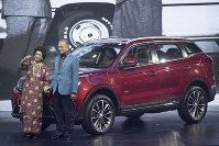 Malaysia Prime Minister Mahathir Mohamad, right, poses with his wife Siti Hasmah during the launch of Proton new SUV in Kuala Lumpur, Malaysia, on Dec. 12, 2018. (AP Photo/Vincent Thian)