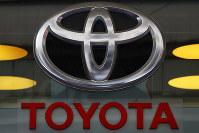 This Sept. 20, 2017, file photo shows the Toyota logo at their shop on the Champs Elysees Avenue in Paris. (AP Photo/Francois Mori)