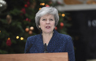 Britain's Prime Minister Theresa May makes a media statement in Downing Street, London, confirming there will be a vote of confidence in her leadership of the Conservative Party, on Dec. 12, 2018. (Stefan Rousseau/PA via AP)