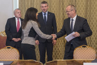 Slovak Defence Minister Peter Gajdos, right, and Lockheed Martin vice-president Ana Wugofski, left, shake hands after signing a 1.6-billion euro deal on the purchase of 14 New F-16 Fighter Jets in Bratislava, on Dec. 12, 2018. (Michal Svitok/TASR via AP)