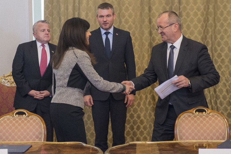 249a0bdb5 Slovak Defense Minister Peter Gajdos, right, and Lockheed Martin  Vice-President Ana Wugofski, left, shake hands after signing a 1.6-billion  euro deal on the ...