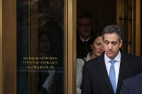 Michael Cohen, President Donald Trump's former personal attorney and fixer, exits federal court after his sentencing hearing in New York on Dec. 12, 2018. (Getty/Kyodo)