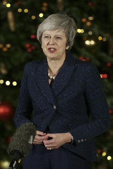British Prime Minister Theresa May makes a statement outside 10 Downing Street, in London, on December 12, 2018. (AP Photo/Tim Ireland)