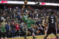 Boston Celtics guard Kyrie Irving (11) shoots with Washington Wizards guard Bradley Beal (3) nearby during the overtime period of an NBA basketball game on Dec. 12, 2018, in Washington. The Celtics won 130-125. (AP Photo/Alex Brandon)