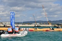 Demonstrators on canoes and a boat protest against land reclamation work to build a new U.S. military base off the coast of the Henoko district of the city of Nago, Okinawa Prefecture, on Dec. 14, 2018. (Mainichi/Takeshi Noda)