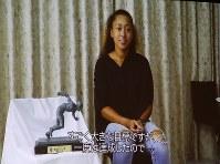 US Open Tennis Champion Naomi Osaka appears in a video message shown during the 2018 Mainichi sporting figure awards ceremony in Tokyo's Bunkyo Ward, on Dec. 13, 2018. (Mainichi/Junichi Sasaki)