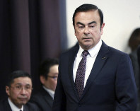 In this May 12, 2016, photo, then Nissan Motor Co. President and CEO Carlos Ghosn attends a joint press conference with Mitsubishi Motors Corp. in Yokohama, near Tokyo. (AP Photo/Eugene Hoshiko)