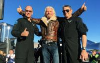 Richard Branson center celebrates with pilots Rick CJ Sturckow, left, and Mark Forger Stucky, right, on Dec. 13, 2018. (AP Photo/John Antczak)