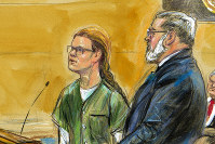 In this courtroom sketch, Maria Butina, left, is shown next to her attorney Robert Driscoll, before U.S. District Judge Tanya Chutkan, during a court hearing at the U.S. District Court in Washington, on Dec. 13, 2018. (Dana Verkouteren via AP)