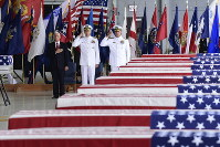 In this Aug. 1, 2018 file photo, U.S. Vice President Mike Pence, left, Commander of U.S. Indo-Pacific Command Adm. Phil Davidson, center, and Rear Adm. Jon Kreitz, deputy director of the POW/MIA Accounting Agency, attend at a ceremony marking the arrival of the remains believed to be of American service members who fell in the Korean War at Joint Base Pearl Harbor-Hickam, Hawaii. (AP Photo/Susan Walsh)