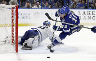 Tampa Bay Lightning center J.T. Miller (10) loses control of the puck as he goes in for a shot on Toronto Maple Leafs goaltender Frederik Andersen (31) during the second period of an NHL hockey game on Dec. 13, 2018, in Tampa, Fla. (AP Photo/Chris O'Meara)