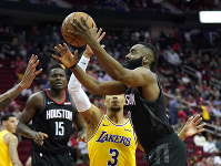 Houston Rockets' James Harden, right, goes up for a shot as Los Angeles Lakers' Josh Hart (3) defends during the second half of an NBA basketball game on Dec. 13, 2018, in Houston. The Rockets won 126-111. (AP Photo/David J. Phillip)