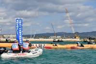 People in canoes and boats protest against the commencement of land reclamation work off the coast of Nago, Okinawa Prefecture, on Dec. 14, 2018. (Mainichi/Takeshi Noda)