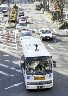 An autonomous bus operates a test run on a public road in the Gunma prefectural capital of Maebashi, on Dec. 14, 2018. (Mainichi/Tatsuya Fujii)