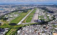 U.S. Marine Corps Air Station Futenma is seen in this photo taken from a Mainichi Shimbun helicopter in Ginowan, Okinawa Prefecture, on Sept. 16, 2018. (Mainichi/Michiko Morisono)