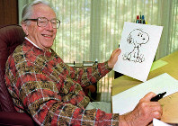 n this Feb. 12, 2000, file photo, cartoonist Charles M. Schulz displays a sketch of his beloved character