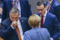 Hungarian Prime Minister Viktor Orban, left, speaks with German Chancellor Angela Merkel, center, and Polish Prime Minister Mateusz Morawiecki during a round table meeting at an EU summit in Brussels, on Dec. 14, 2018. (Stephanie Lecocq, Pool Photo via AP)