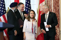 Secretary of State Mike Pompeo, second from left, and Defense Secretary Jim Mattis right, and their Canadian counterparts Canadian Minister of Foreign Affairs Chrystia Freeland, second from right, and Canadian Minister of Defense Harjit Sajjan, left, leave the Benjamin Franklin Room as they conclude their news conference following a U.S.-Canada 2+2 Ministerial at the State Department in Washington, on Dec. 14, 2018. (AP Photo/Manuel Balce Ceneta)