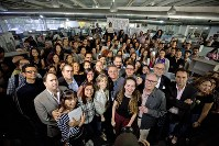 Journalists and supporters of El Nacional newspaper pose for group photo in the newsroom in Caracas, Venezuela, on Dec. 14, 2018. (AP Photo/Fernando Llano)