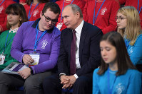 Russian President Vladimir Putin, center, attends a high-tech forum for youth in Yaroslavl, Russia, Thursday, Dec. 13, 2018. (Alexei Druzhinin, Sputnik, Kremlin Pool Photo via AP)