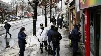 Police officers investigate damage surrounding the site where an explosion occurred the previous night in Sapporo's Toyohira Ward on Dec. 17, 2018. (Mainichi/Taichi Kaizuka)