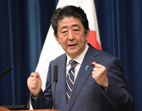 Prime Minister Shinzo Abe answers questions at a news conference at the prime minister's office in Tokyo's Chiyoda Ward on Dec. 10, 2018, after the extraordinary Diet session closed. (Mainichi/Masahiro Kawata)