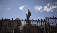 A statue of the late Paul Kruger stands in Church Square, Pretoria, South Africa, on Dec. 13, 2018, protected from protesters by a fence. (AP Photo)