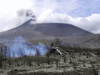 In this July 3, 2011, file photo, shows Mount Soputan seen from Tombatu village in North Sulawesi, Indonesia. Mount Soputan, located on the northern part of Sulawesi island, erupted twice on Dec. 16, 2018, according to the national disaster agency's spokesman, Sutopo Purwo Nugroho. (AP Photo/Grace Wakary)