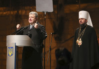 Ukrainian President Petro Poroshenko, left, speaks to people as a new elected head of independent Ukrainian church Metropolitan of Kiev Epiphanius looks on near the St. Sophia Cathedral in Kiev, Ukraine, on Dec. 15, 2018. (AP Photo/Efrem Lukatsky)