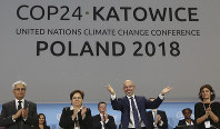 Michal Kurtyka, a senior Polish official chairing the negotiations, poses for a photo after adopting the final agreement during a closing session of the COP24 U.N. Climate Change Conference 2018 in Katowice, Poland, on Dec. 15, 2018. (AP Photo/Czarek Sokolowski)