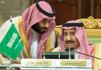 In this photo released by the state-run Saudi Press Agency, Saudi Crown Prince Mohammed bin Salman, left, speaks to his father, King Salman at a meeting of the Gulf Cooperation Council in Riyadh, Saudi Arabia, on Dec. 9, 2018. (Saudi Press Agency via AP)