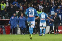 Napoli's Arkadiusz Milik, right, celebrates after scoring the winning goal during the Italian Serie A soccer match between Cagliari and Napoli at the Sardegna Arena stadium in Cagliari, Italy, Sunday, Dec. 16, 2018. (Fabio Murru/ANSA via AP)
