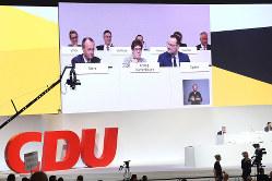 CDUは分断された党と評された Bloomberg