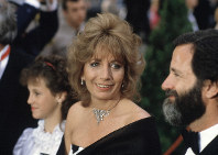In this April 9, 1984 file photo, actress Penny Marshall arrives for the 56th Annual Academy Awards in Los Angeles. Marshall died of complications from diabetes on Monday, Dec. 17, 2018, at her Hollywood Hills home. She was 75. (AP Photo/Reed Saxon)