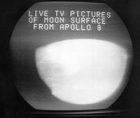 This Dec. 24, 1968, file photo shows a television screen with a view of the moon transmitted by the Apollo 8 astronauts as it orbited. The curves within the television image are caused by the edges of the spacecraft windows and the lunar horizon. (AP Photo/Anthony Camerano)