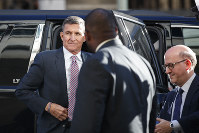 President Donald Trump's former National Security Advisor Michael Flynn arrives at federal court in Washington, on Dec. 18, 2018. (AP Photo/Carolyn Kaster)