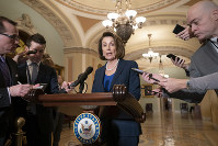 U.S. House Democratic Leader Nancy Pelosi of California, the speaker-designate for the new Congress in January, talks to reporters after meeting with Senate Minority Leader Chuck Schumer, D-N.Y., in Washington, on Dec. 18, 2018. (AP Photo/J. Scott Applewhite)