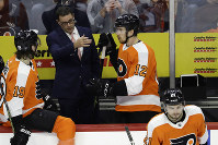Philadelphia Flyers interim head coach Scott Gordon, center, talks with Nolan Patrick, left, and Michael Raffl during the third period of an NHL hockey game against the Detroit Red Wings, on Dec. 18, 2018, in Philadelphia. Philadelphia won 3-2. (AP Photo/Matt Slocum)