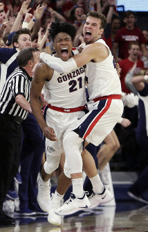 Gonzaga's Rui Hachimura (21) celebrates his go-ahead basket with teammate Corey Kispert during the second half of an NCAA college basketball game against Washington in Spokane, Washington, on Dec. 5, 2018. (AP Photo/Young Kwak)
