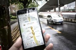 滴滴の配車アプリは、高級車を呼べるなど機能も多様化している(上海) Bloomberg