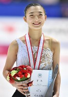 Kaori Sakamoto smiles after winning the Japan national figure skating championships for the first time at Towa Pharmaceutical Co.'s Ractab Dome in the city of Kadoma, Osaka Prefecture, on Dec. 23, 2018. (Mainichi/Kenji Ikai)