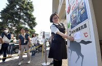 A female employee of a department store places a handwritten sign showing that the high temperature hit 41.1 Celsius degrees, which is the hottest ever recorded in Japan, in the city of Kumagaya, Saitama Prefecture, north of Tokyo, on July 23, 2018. The sign was made on the spot because store clerks didn't expect the mercury that high. (Mainichi/Hiroshi Maruyama)