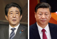 Japanese Prime Minister Shinzo Abe, left, and Chinese President Xi Jinping (AP)