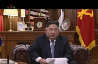 In this undated image from video distributed on Jan. 1, 2019, by North Korean broadcaster KRT, North Korean leader Kim Jong Un delivers a speech in North Korea. (KRT via AP)
