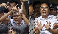 In this combination photo, Reuters journalists Kyaw Soe Oo, left, and Wa Lone are handcuffed as they are escorted by police out of the court in Yangon, Myanmar, on Sept. 3, 2018. (AP Photo/Thein Zaw)