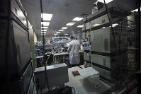 In this photo taken on May 24, 2016, Employees work in Russia's national drug-testing laboratory in Moscow, Russia. (AP Photo/Alexander Zemlianichenko)